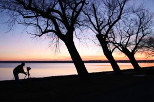 Dave Duprey filming a sunset on Seneca Lake